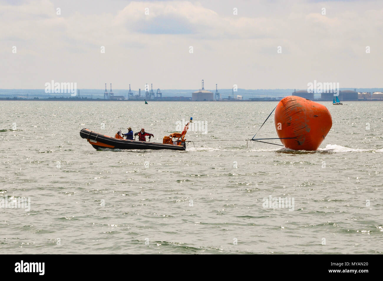Southend Airshow clear up. Towing huge buoy back to shore which had marked out the air display line in the Thames Estuary. Southend on Sea seafront - Stock Image