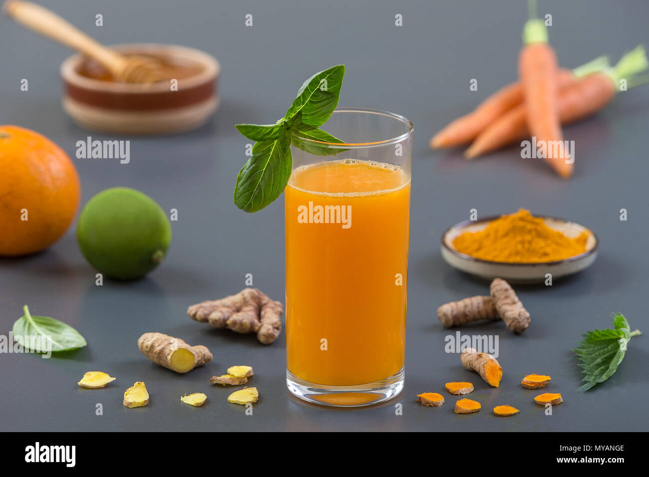 Carrot ginger immune boosting, anti inflammatory smoothie with turmeric and honey. Detox morning juice drink, - Stock Image