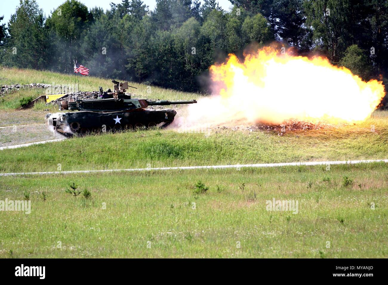 Soldiers from 2nd Battalion, 70th Armor Regiment, 2nd Armored Brigade Combat Team, 1st Infantry Division, fire at a target while conducting the defensive position live fire portion of the Strong Europe Tank Challenge at the Grafenwoehr Training Area, Germany, on June 5.The Strong Europe Tank Challenge is an annual training event designed to give participating nations a dynamic, productive and fun environment in which to foster military partnerships, form Soldier-level relationships, and share tactics, techniques and procedures, June 5, 2018. The participating nations this year are Austria, Fra - Stock Image
