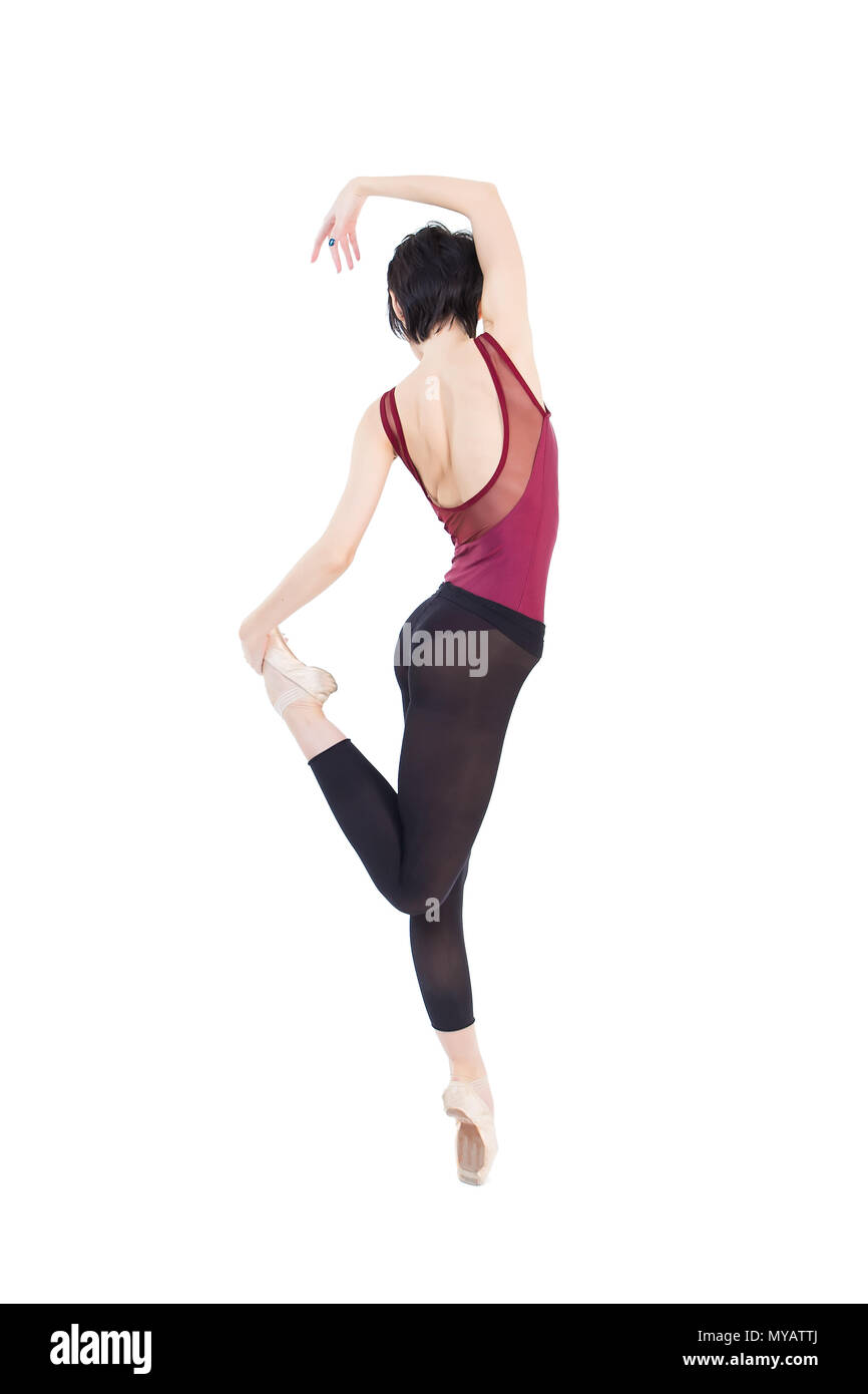 ballerina is dancing in the studio on a white background isolate - Stock Image