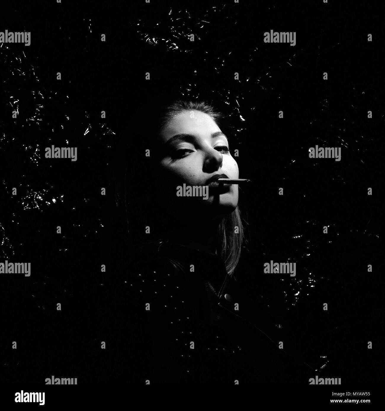 Black and White Smoking Woman - Stock Image