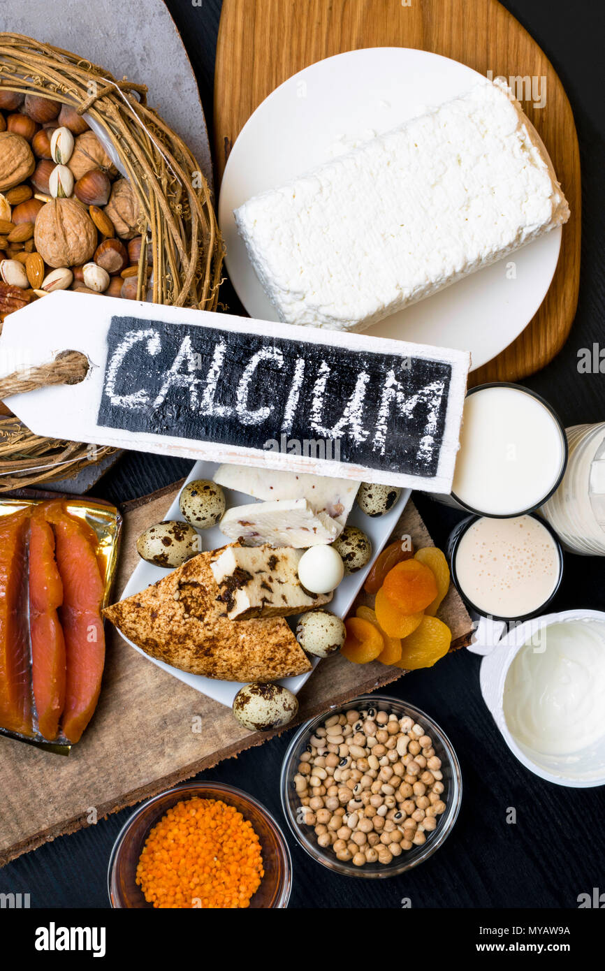Food Rich In Calcium Such As Nuts Milk Peas Lentils Kidney Beans Cottage Cheese Yogurt Buttermilk Dried Apricots Salmonhealthy Food Flat Lay Stock Photo Alamy