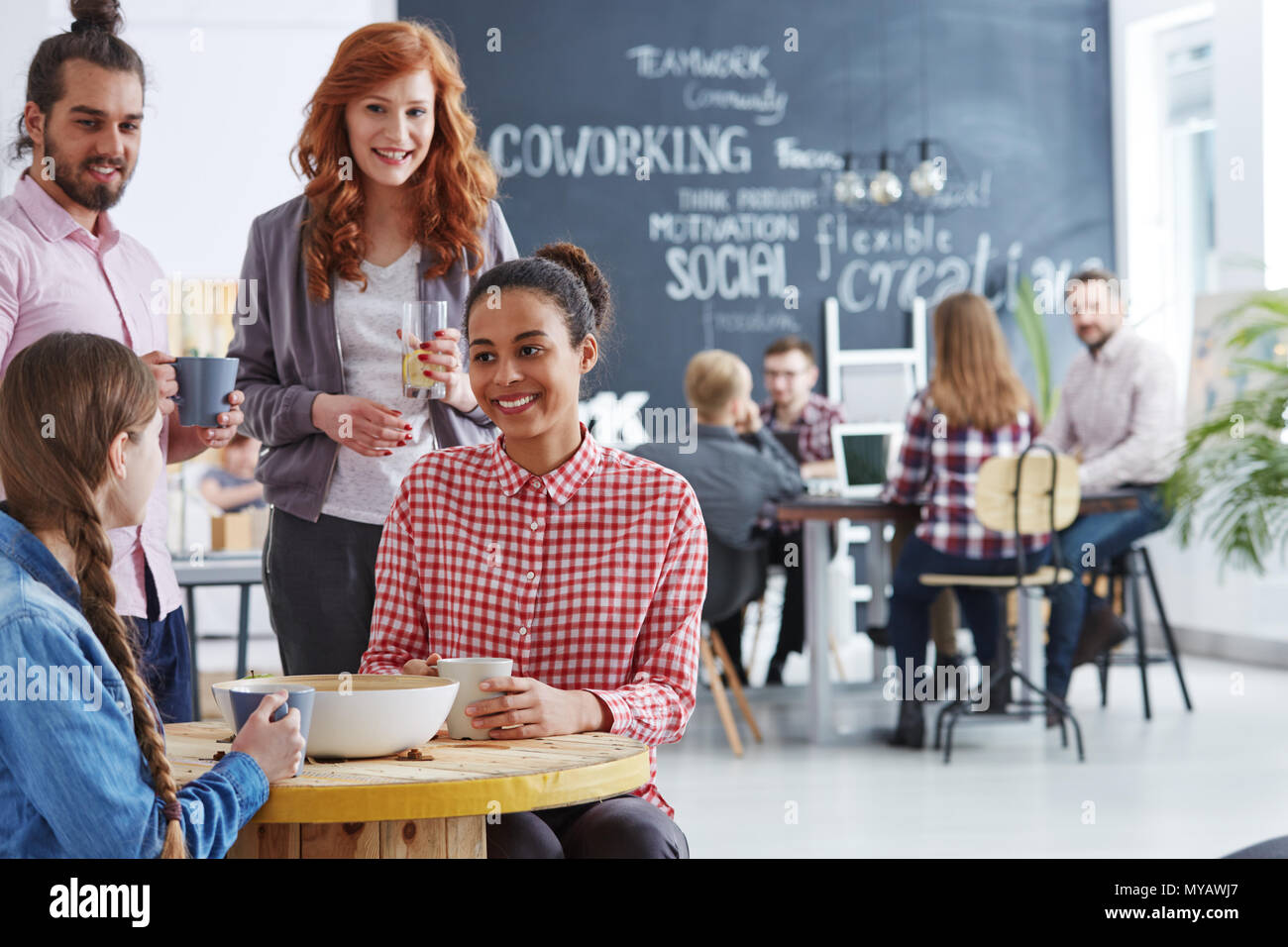 Young and creative business team having coffee break - Stock Image