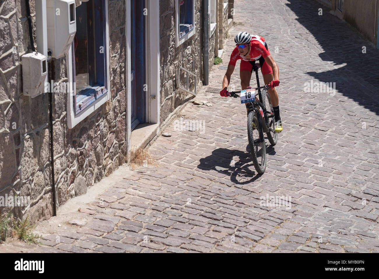 Turkish male cyclist competes in an international mountain bike race in the Greek village of Molyvos on the island of Lesvos - Stock Image