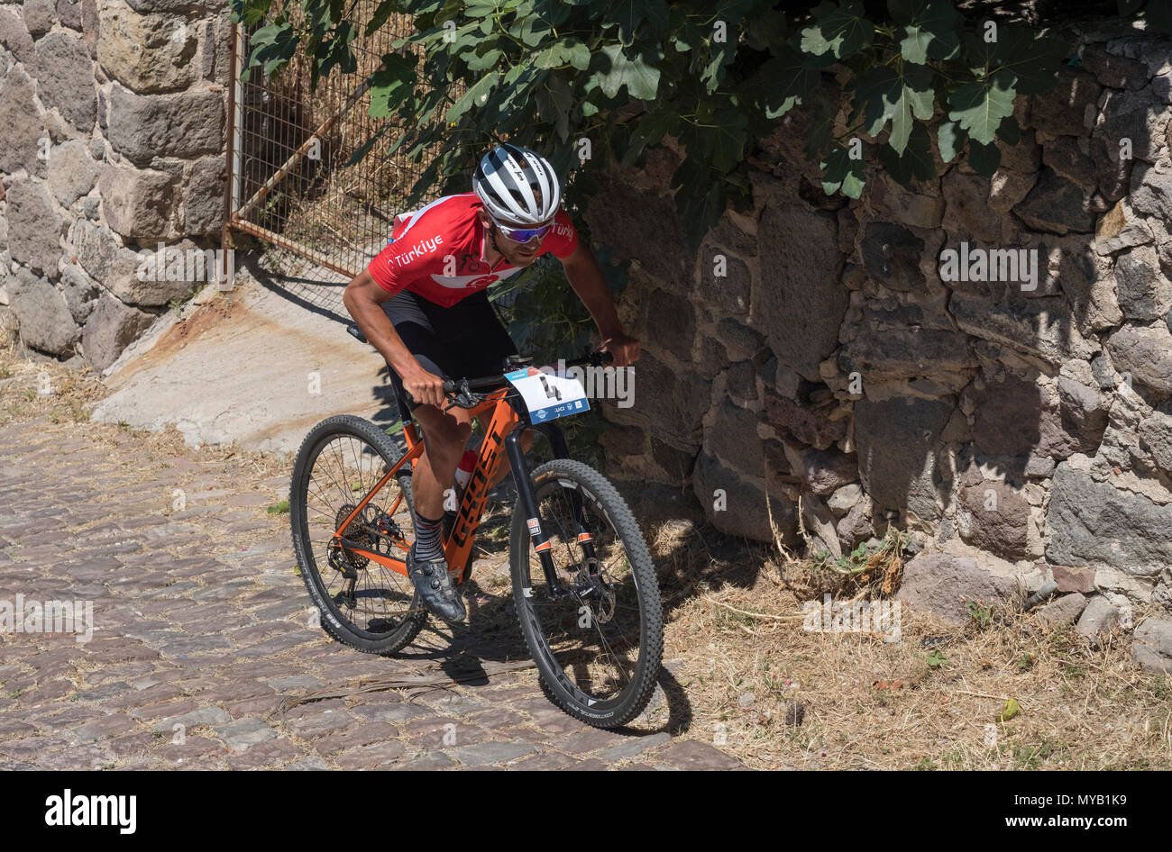 Turkish male cyclist competes in an international mountain bike race in the urban course outside the Greek village of Molyvos on the island of Lesvos - Stock Image