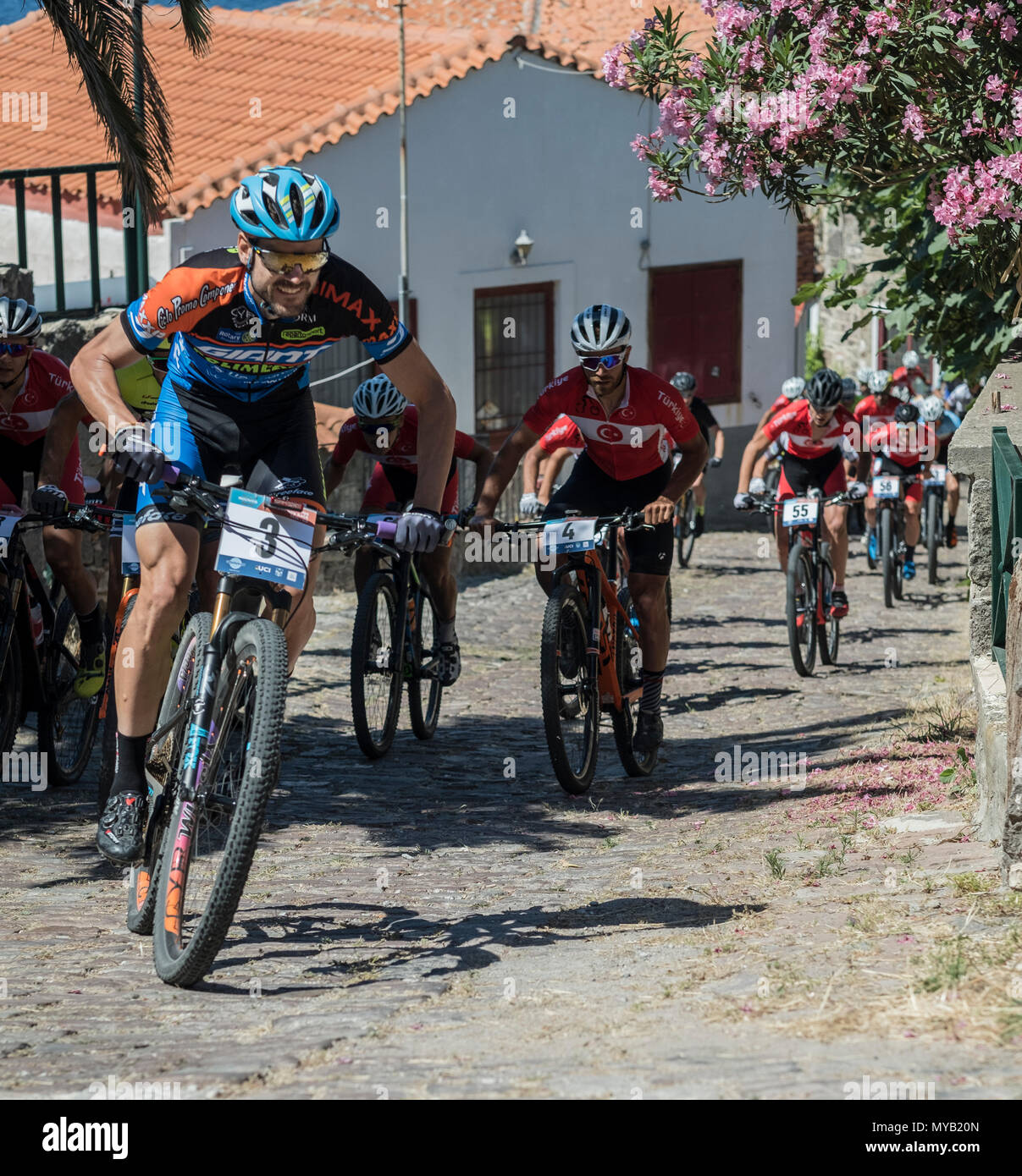 The initial pack of cyclists on the first lap of an international mountain bike race in the Greek village of Molyvos on the island of Lesvos Stock Photo