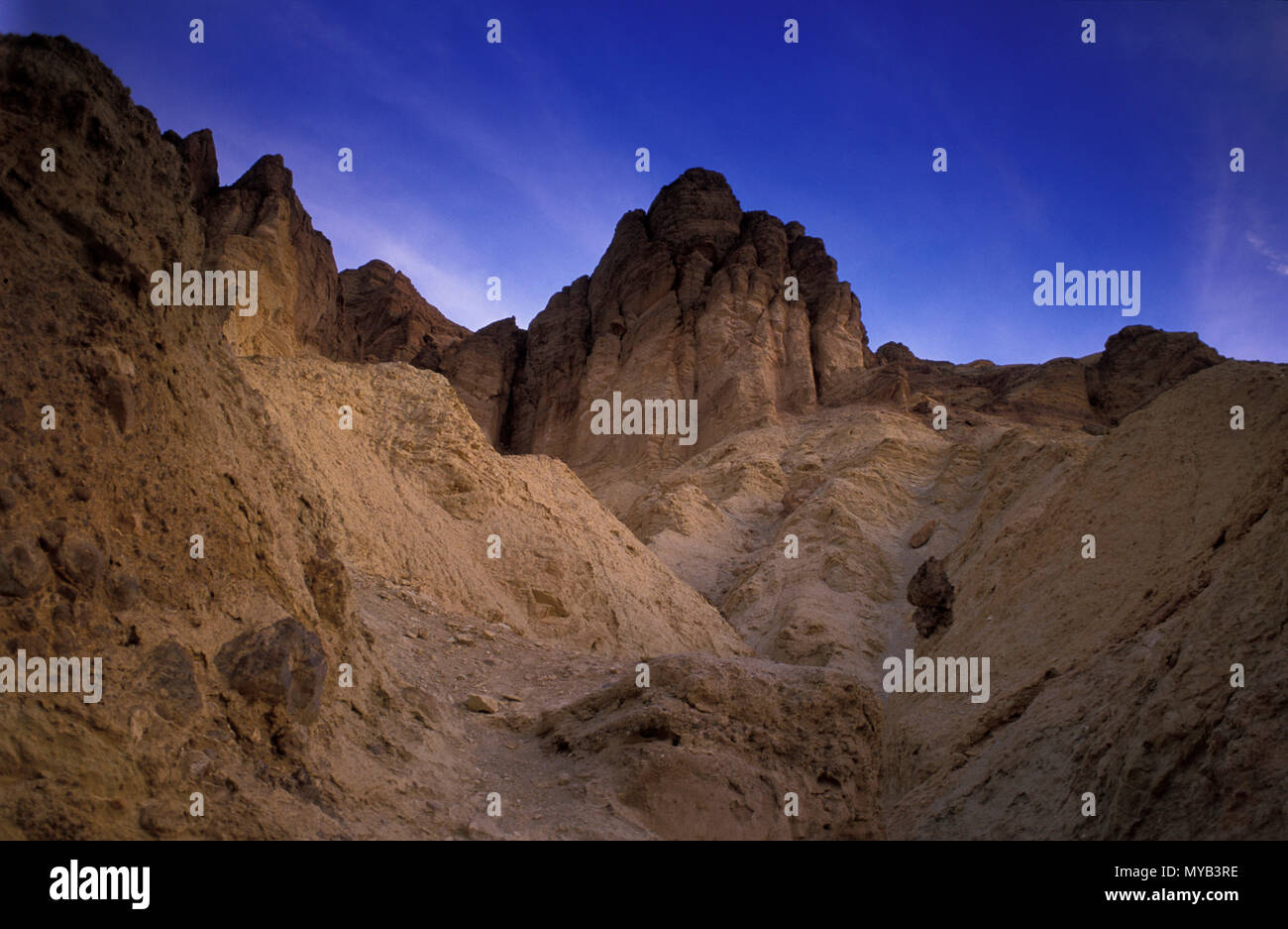 Twilight in Badwater Canyon with dramatic rock formation, Death Valley, CA, USA Stock Photo