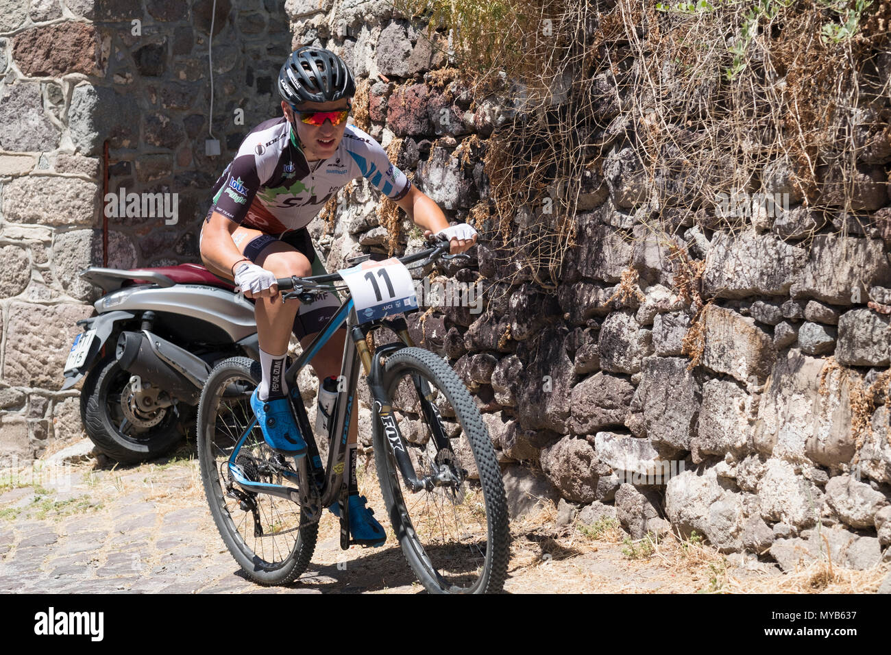 Female Dutch cyclist competes in an international mountain bike race in the Greek village of Molyvos on the island of Lesvos - Stock Image