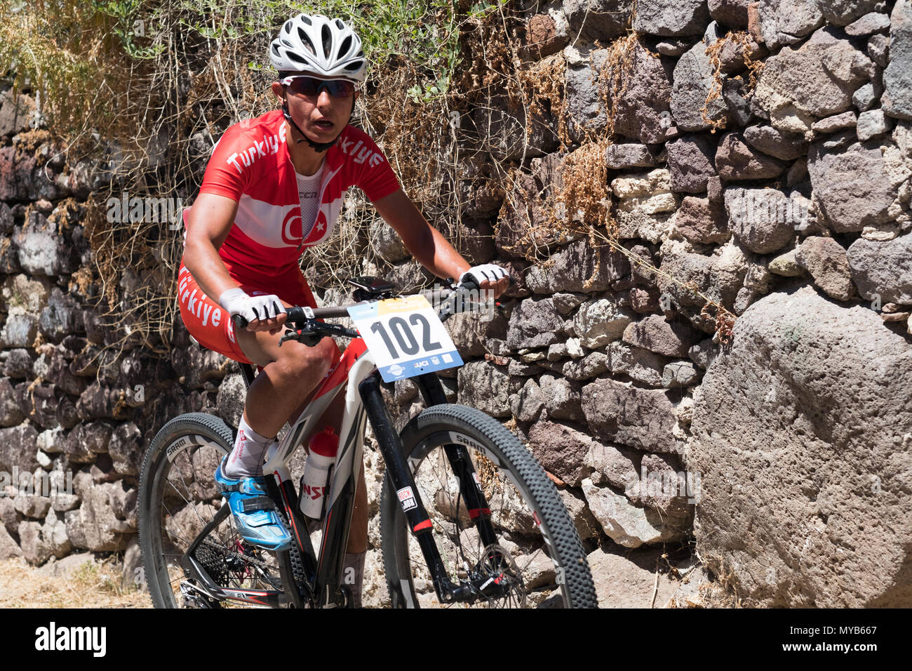 Female Turkish cyclist competes in an international mountain bike race in the Greek village of Molyvos on the island of Lesvos - Stock Image