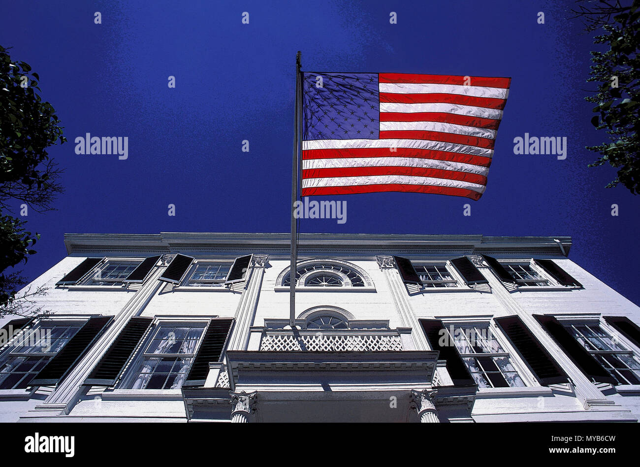 Nickels-Sortwell House with American flag, view looking up (rendered slightly in PS), Wiscasset, Maine, USA Stock Photo