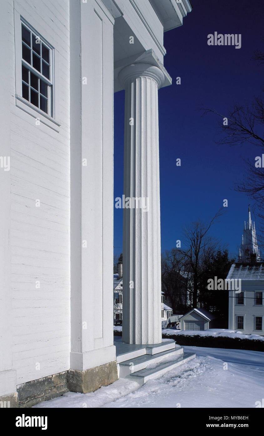 Side view of a Greek Revival church with a greek-like baseless Doric wood column, with townscape in winter, Wiscasset, Maine, USA Stock Photo