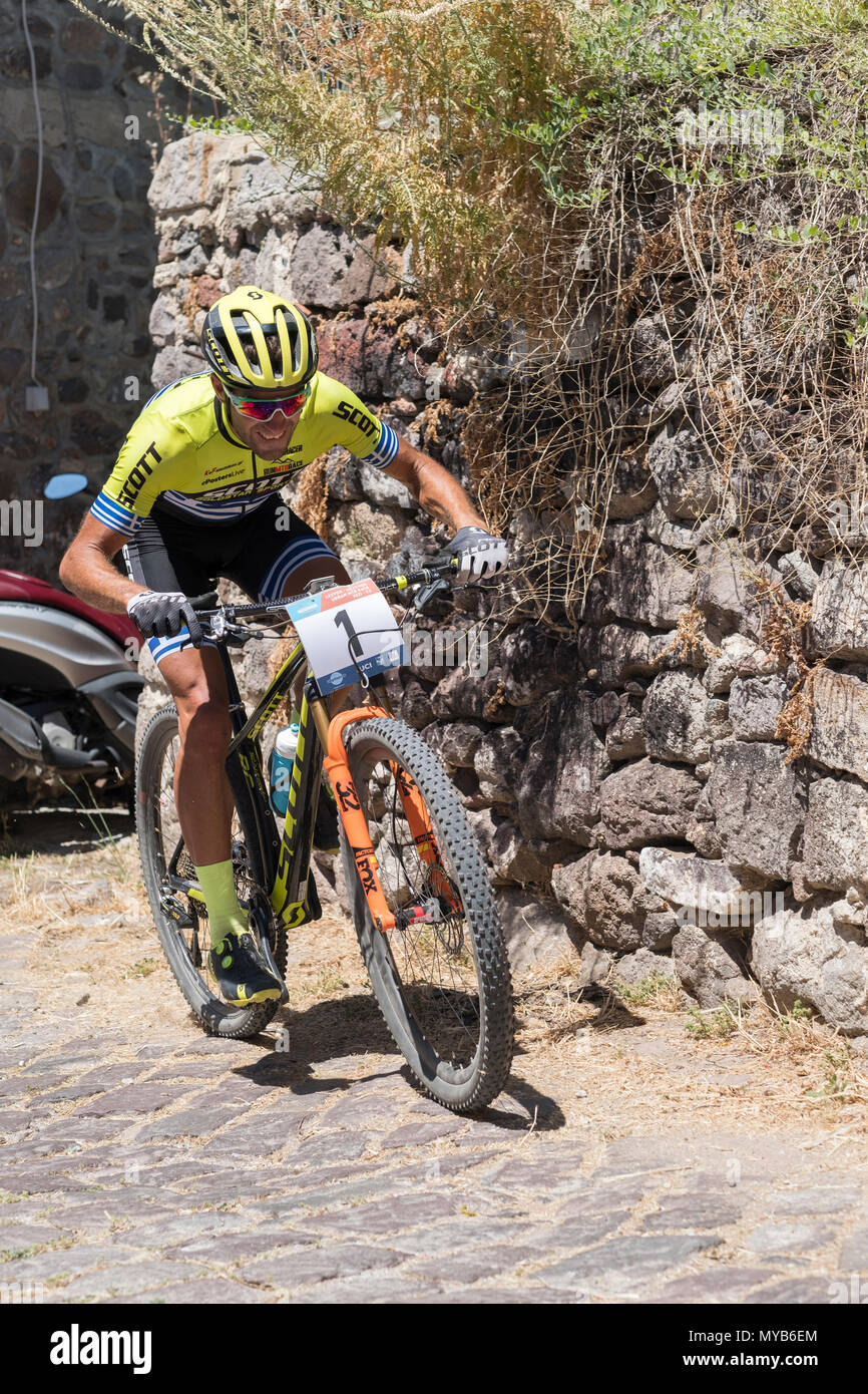 Greek cyclist competes in an international mountain bike race in the Greek village of Molyvos on the island of Lesvos - Stock Image