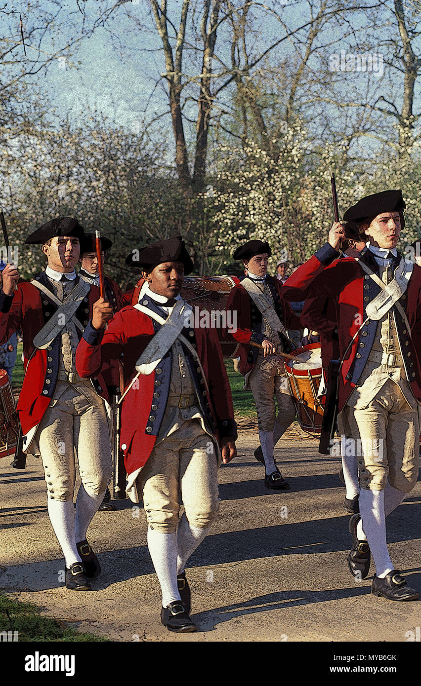 The Colonial Williamsburg Senior Fife and Drum Corp marching in columns of twos, with fifes and drum, multiracial,  Colonial Williamsburg, VA, USA Stock Photo