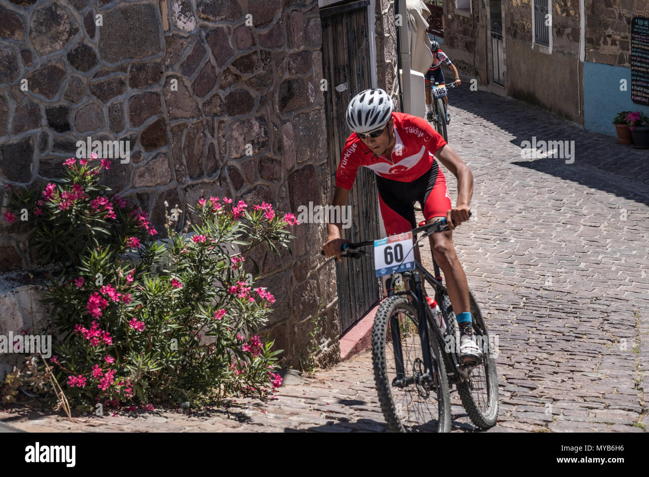 Turkish cyclist competes in an international mountain bike race in the Greek village of Molyvos on the island of Lesvos - Stock Image