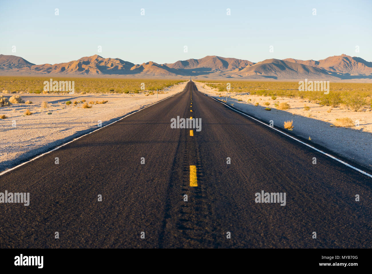 Lonely desert road into Death Valley from the ghost town of Rhyolite, Nevada, North America Stock Photo