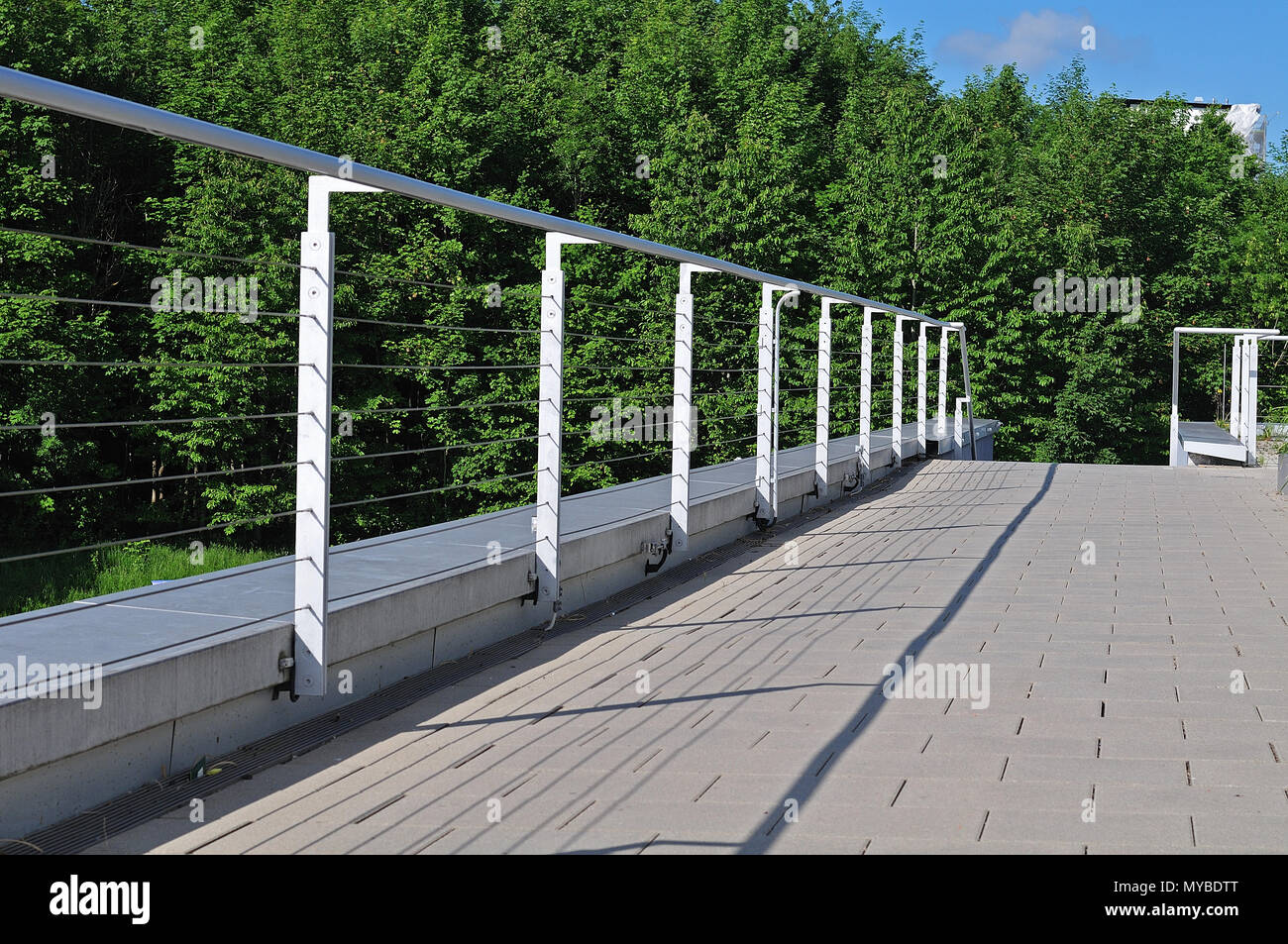 railing at a terrace constructed with steel posts and wire ropes ...