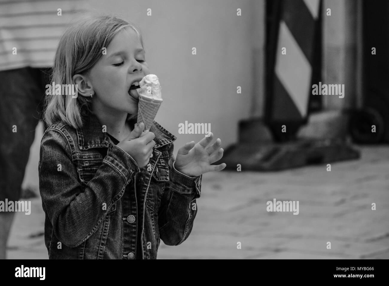 Icecream eating child. - Stock Image