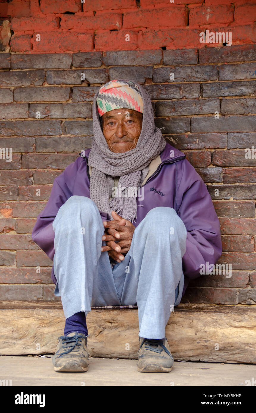 Elderly man with traditional Nepali headware in Bhaktapur, Nepal - Stock Image