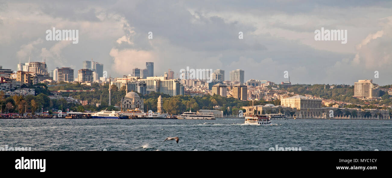 September 1, 2014: Panoramic view of Istanbul with ferry boats in the harbour - Stock Image