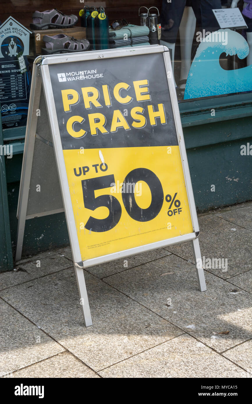 Price reduction shop poster - metaphor for struggling retailers and death of the high street, high street squeeze. Stock Photo
