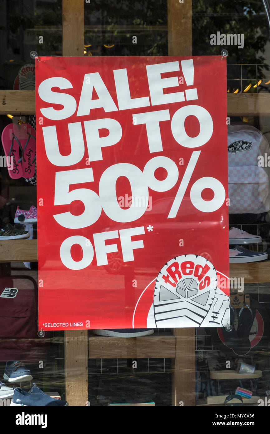 Price reduction shop poster - metaphor for struggling retailers and death of the high street, high street squeeze, retail squeeze. Stock Photo