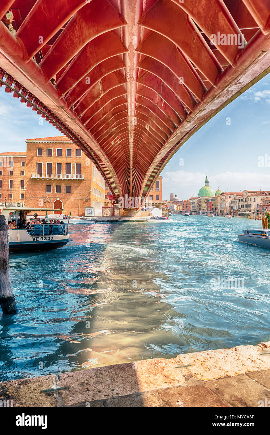 VENICE, ITALY - APRIL 29: Underneath the controversial Constitution Bridge in Venice, Italy on April 29, 2018. Designed by the starchitect Santiago Ca - Stock Image