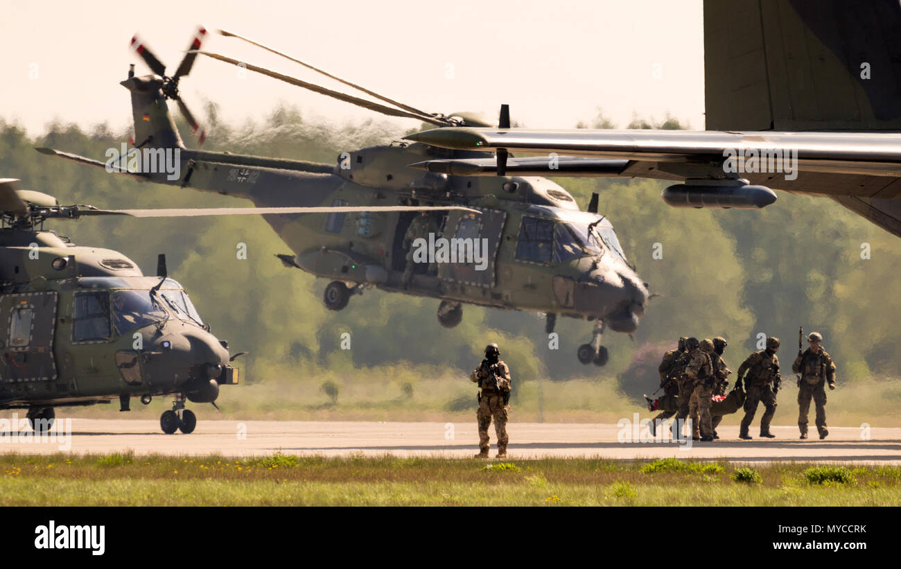 BERLIN, GERMANY - APR 27, 2018: German military NH90 troop helicopter and special forces performing a military demonstration at the Berlin ILA Air Sho Stock Photo