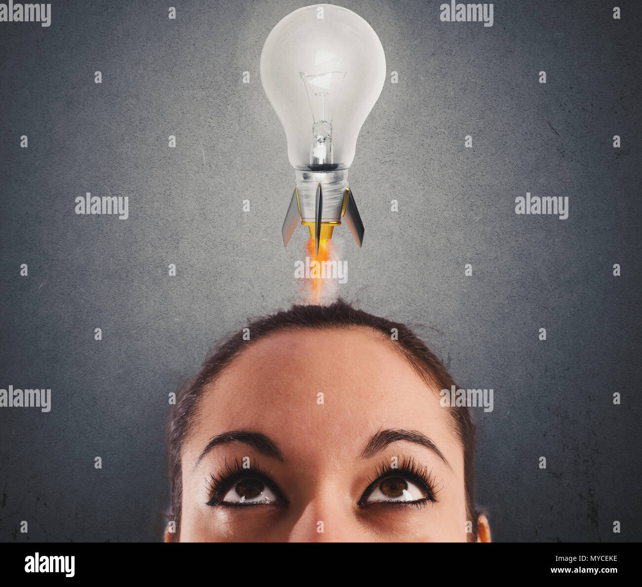 Fast lightbulb as a rocket ready to fly. Concept of new super idea - Stock Image
