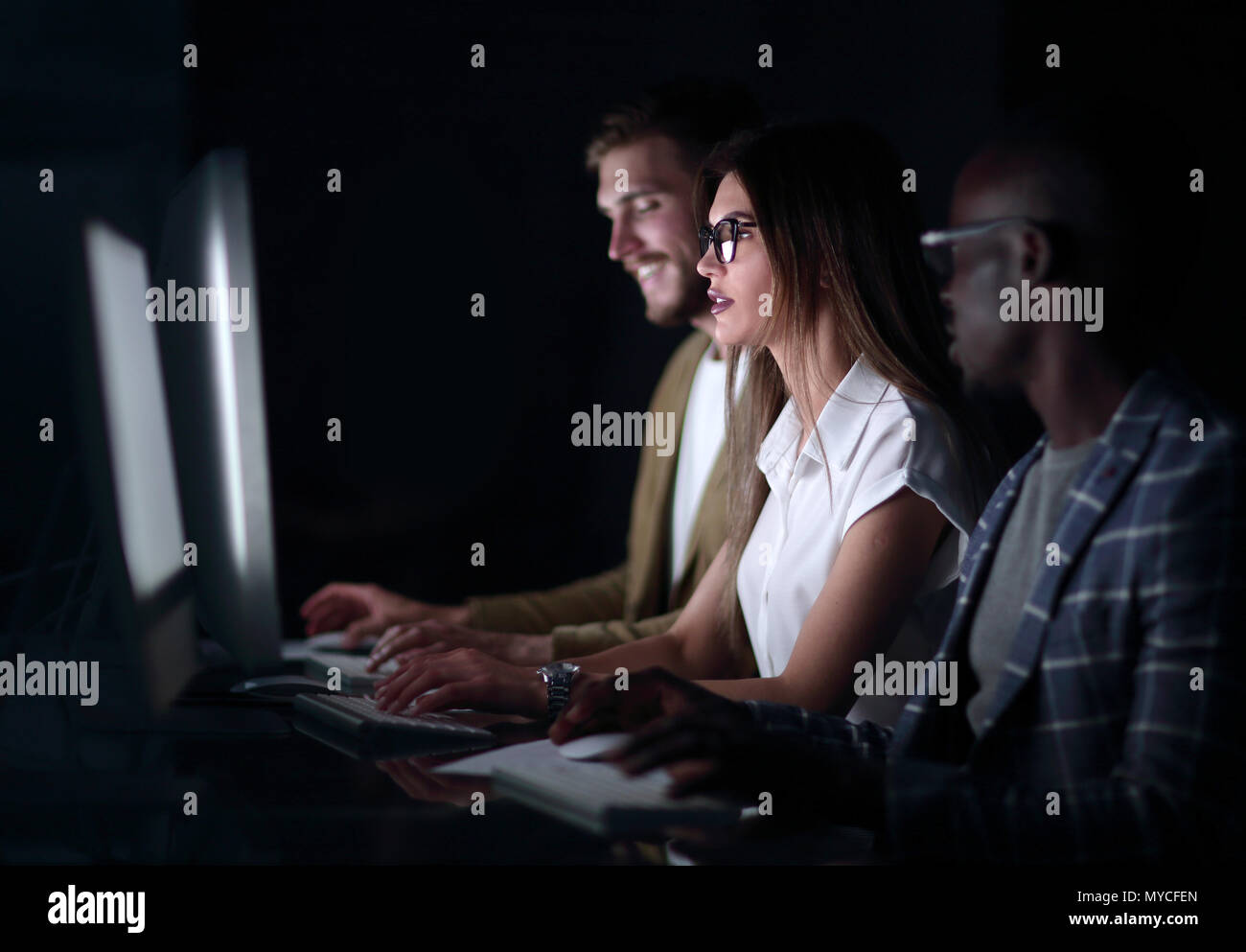 close up.a group of young people working on computers - Stock Image