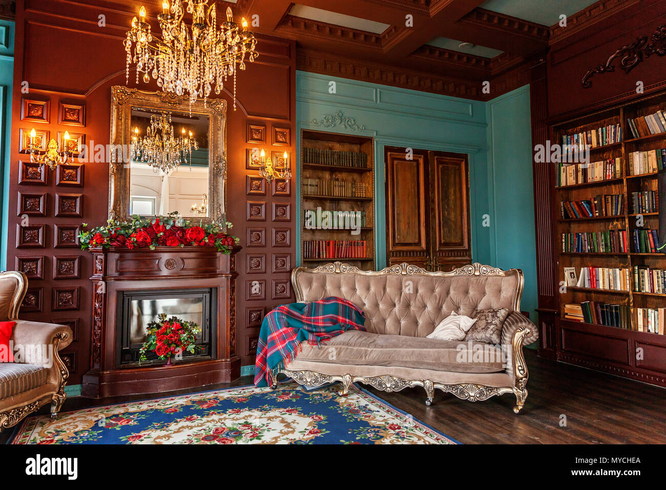 Luxury Classic Interior Of Home Library. Sitting Room With Bookshelf,  Books, Arm Chair, Sofa And Fireplace. Clean And Modern Decoration With  Elegant F