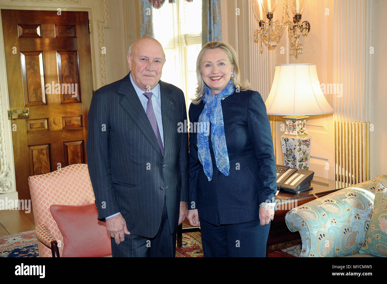 U.S. Secretary of State Hillary Rodham Clinton meets with F.W. de Klerk, former President of the Republic of South Africa, at the U.S. Department of State in Washington, D.C., on March 6, 2012 Stock Photo