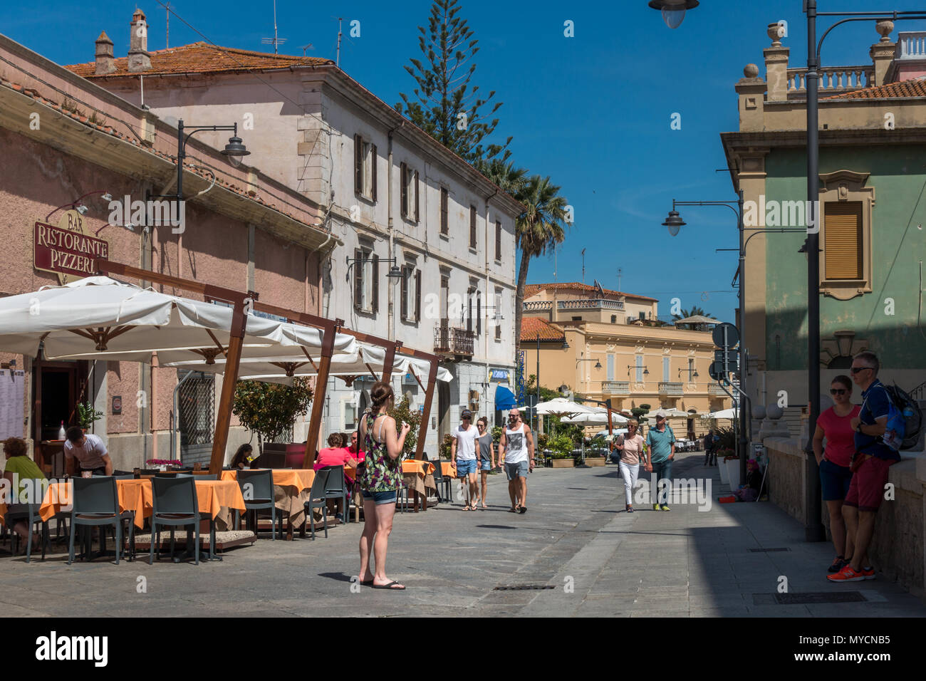 Main tourist street of Olbia old town with cafes and restaurants, Sardinia - Stock Image