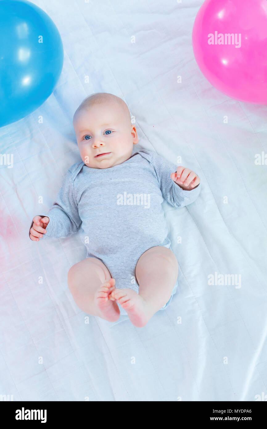 Baby boy lying on back. - Stock Image