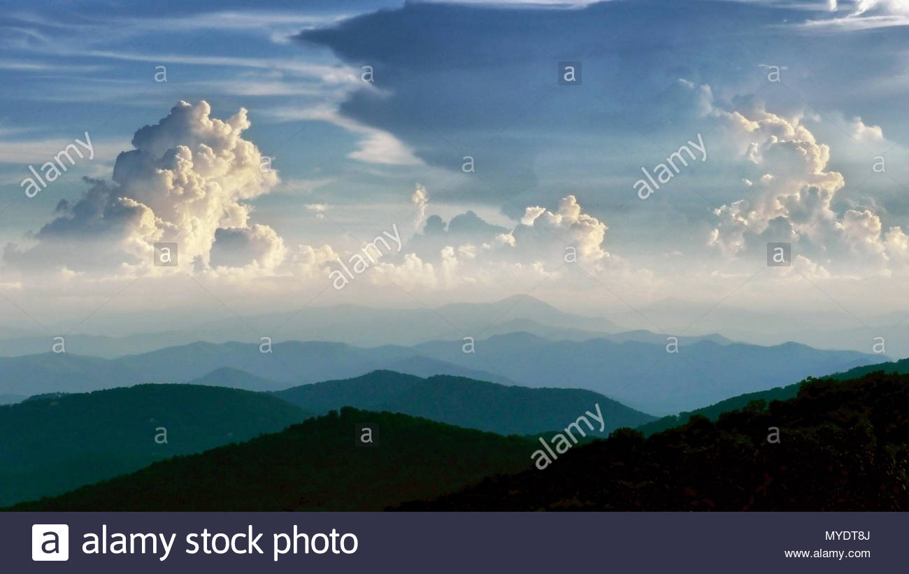 Cumulonimbus thunderhead clouds form over the Blue Ridge Mountains on a summer day. - Stock Image
