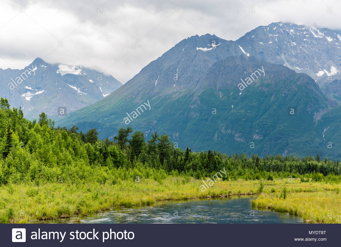 The Chugach Mountains Tower Over Alaska's Eagle River - Stock Image