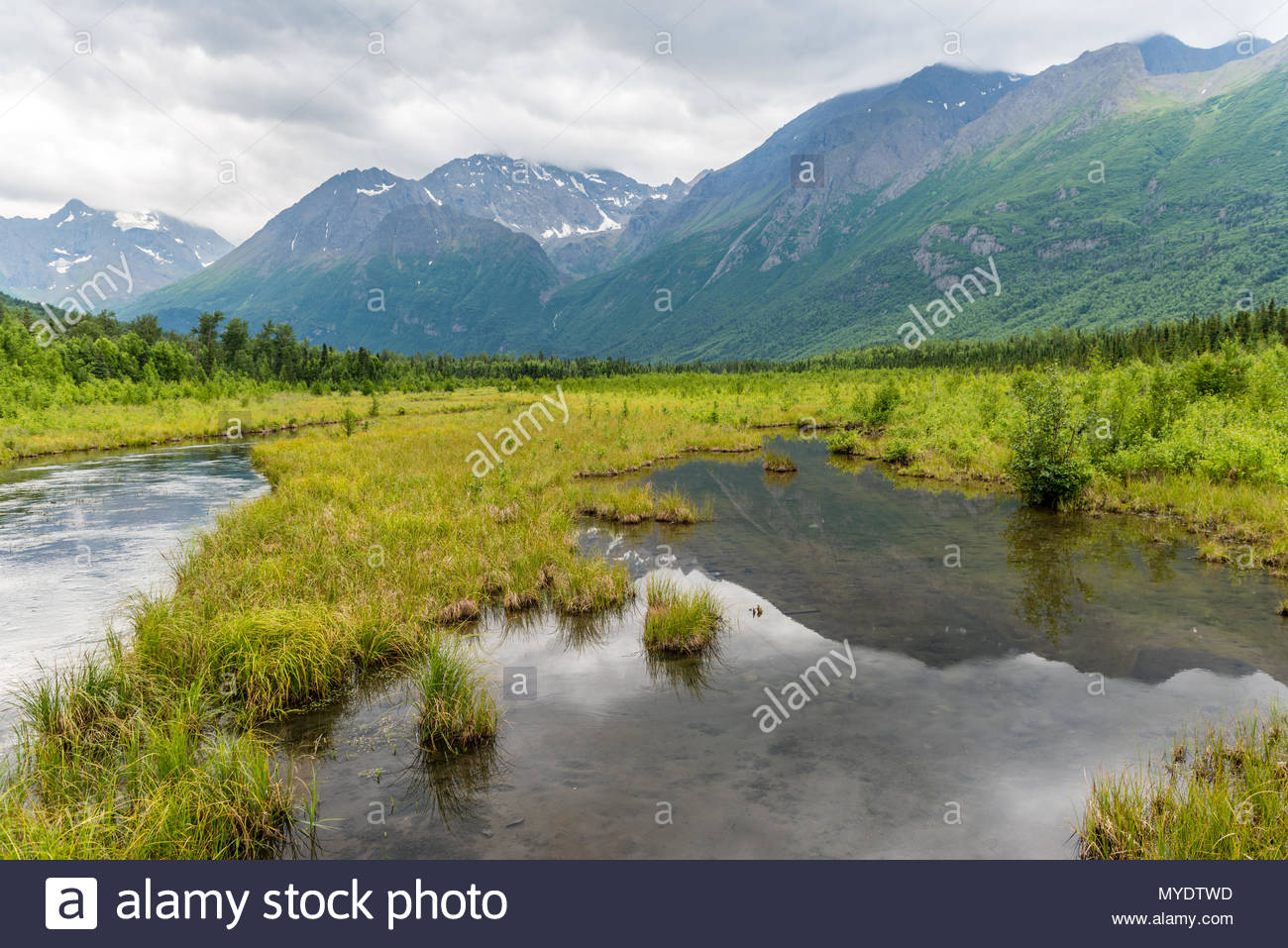 Alasaka's Eagle River Reflects the Chugach Mountains - Stock Image