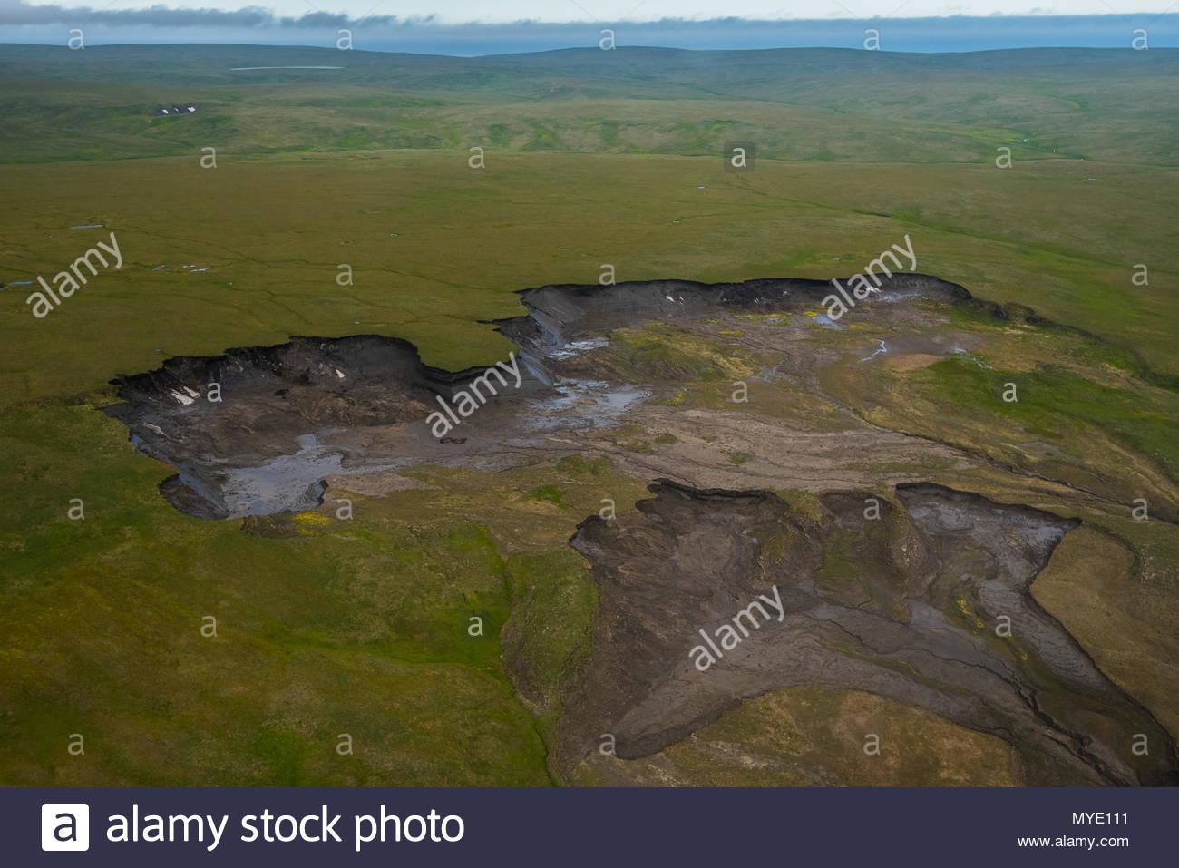 A massive permafrost thaw slump near the Arctic Ocean coastline. - Stock Image
