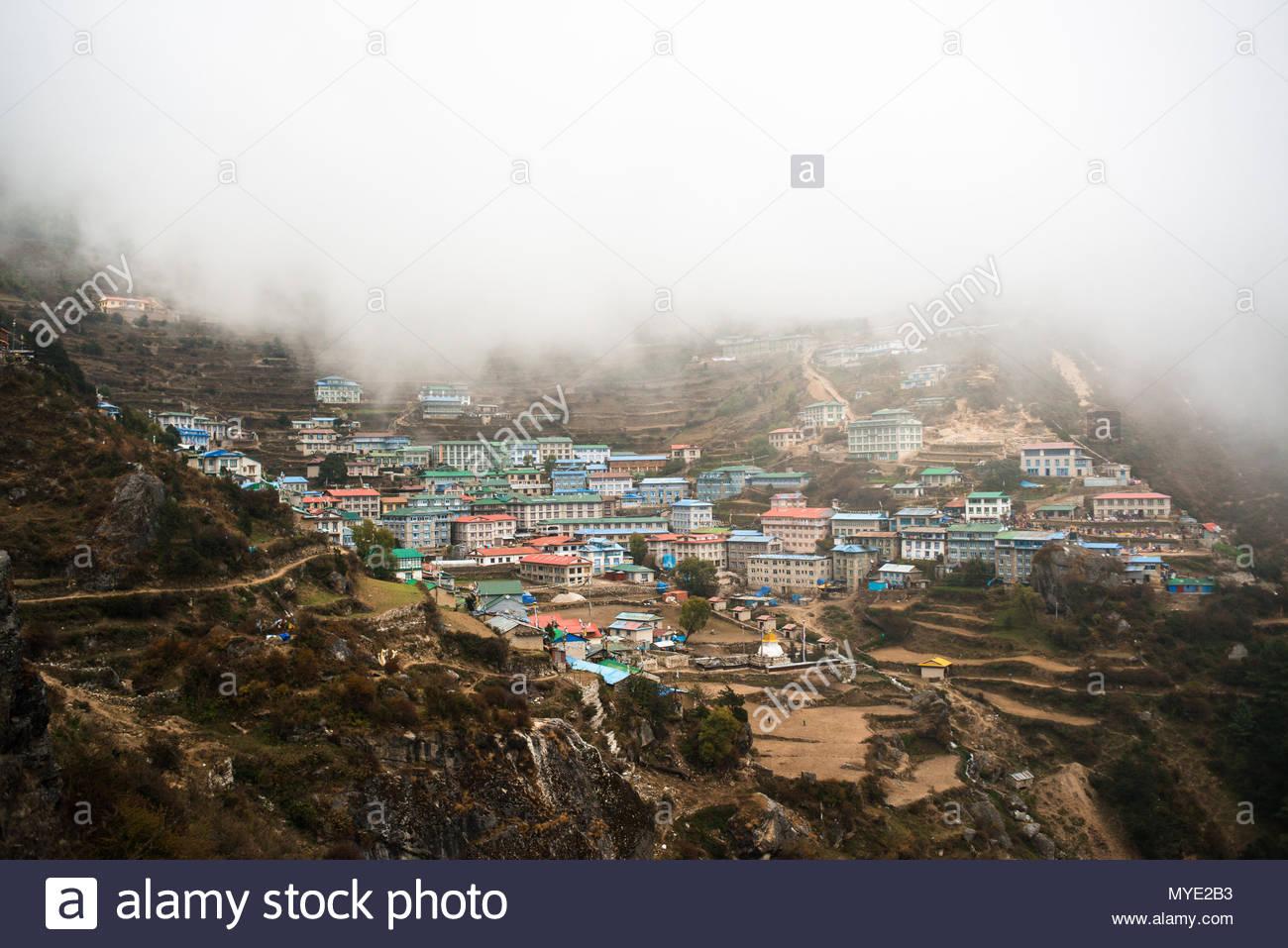 Namche Bazaar, shrouded in fog. - Stock Image