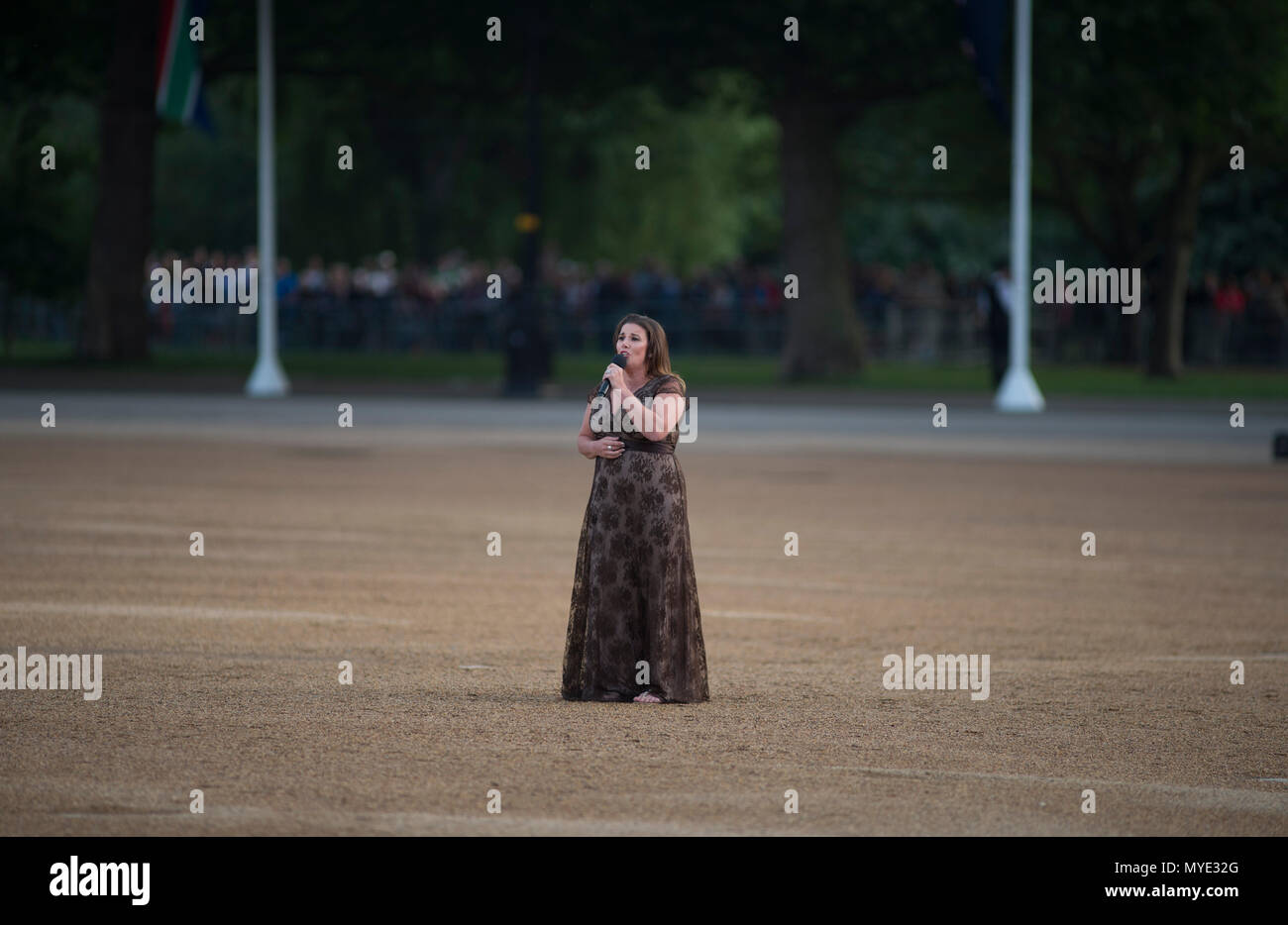 Horse Guards, London, UK. 6 June, 2018. Sam Bailey, winner of X Factor performs in front of VIP guests and the Massed Bands of the Household Division on Horse Guards Parade in the annual evening celebration that is the Household Division's Beating Retreat. Credit: Malcolm Park editorial/Alamy Live News - Stock Image