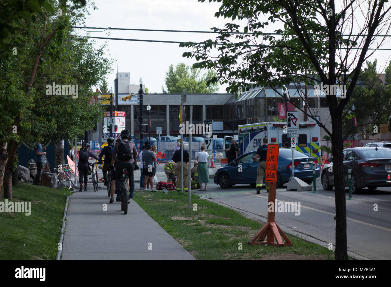 June 6th, 2018; Calgary, Alberta. Paramedics arrive on scene where a cyclists was hit in the bike lane by a vehicle turning left into the alley between 16th and 17th Avenue SW and 5th Street SW. Credit: M.J. Daviduik/Alamy Live News - Stock Image