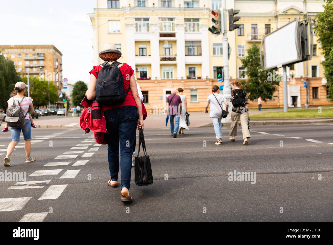 People cross the road on the pedestrian crossing Stock Photo