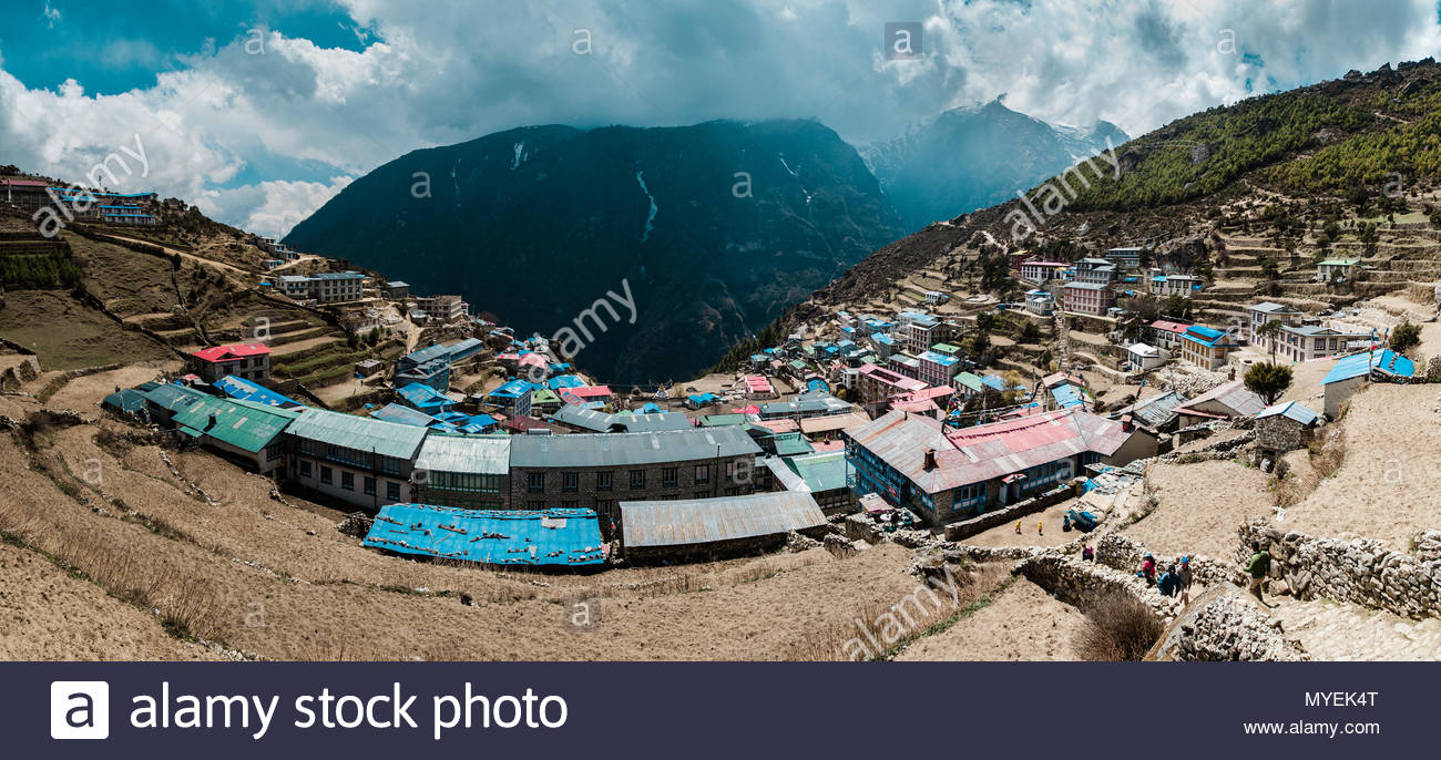 Panoramic view of Namche Bazaar with heavy clouds in the background. - Stock Image