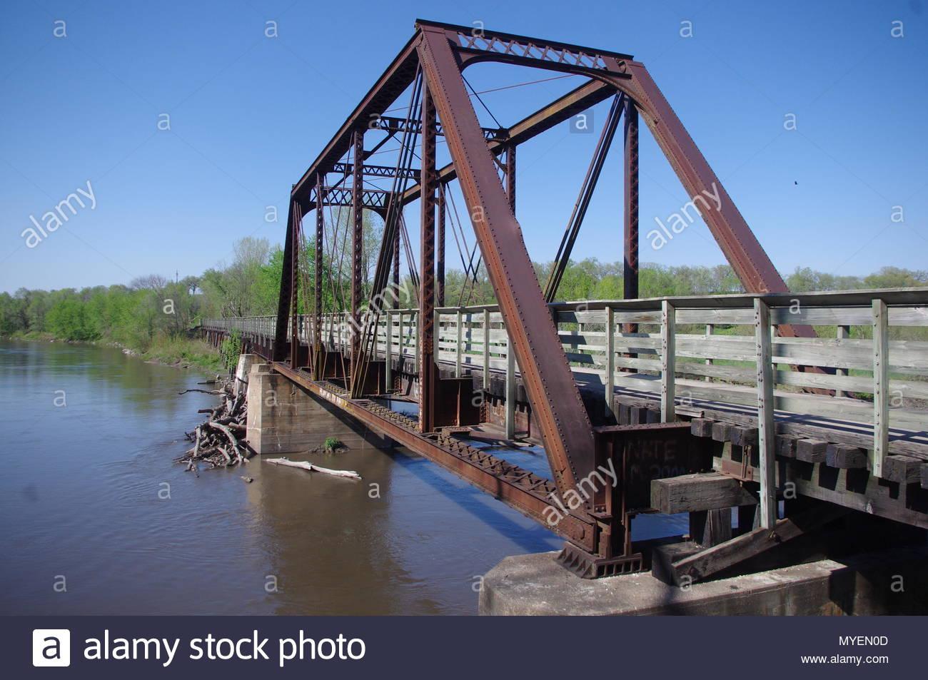 Rails-To-Trails bridge over river - Stock Image