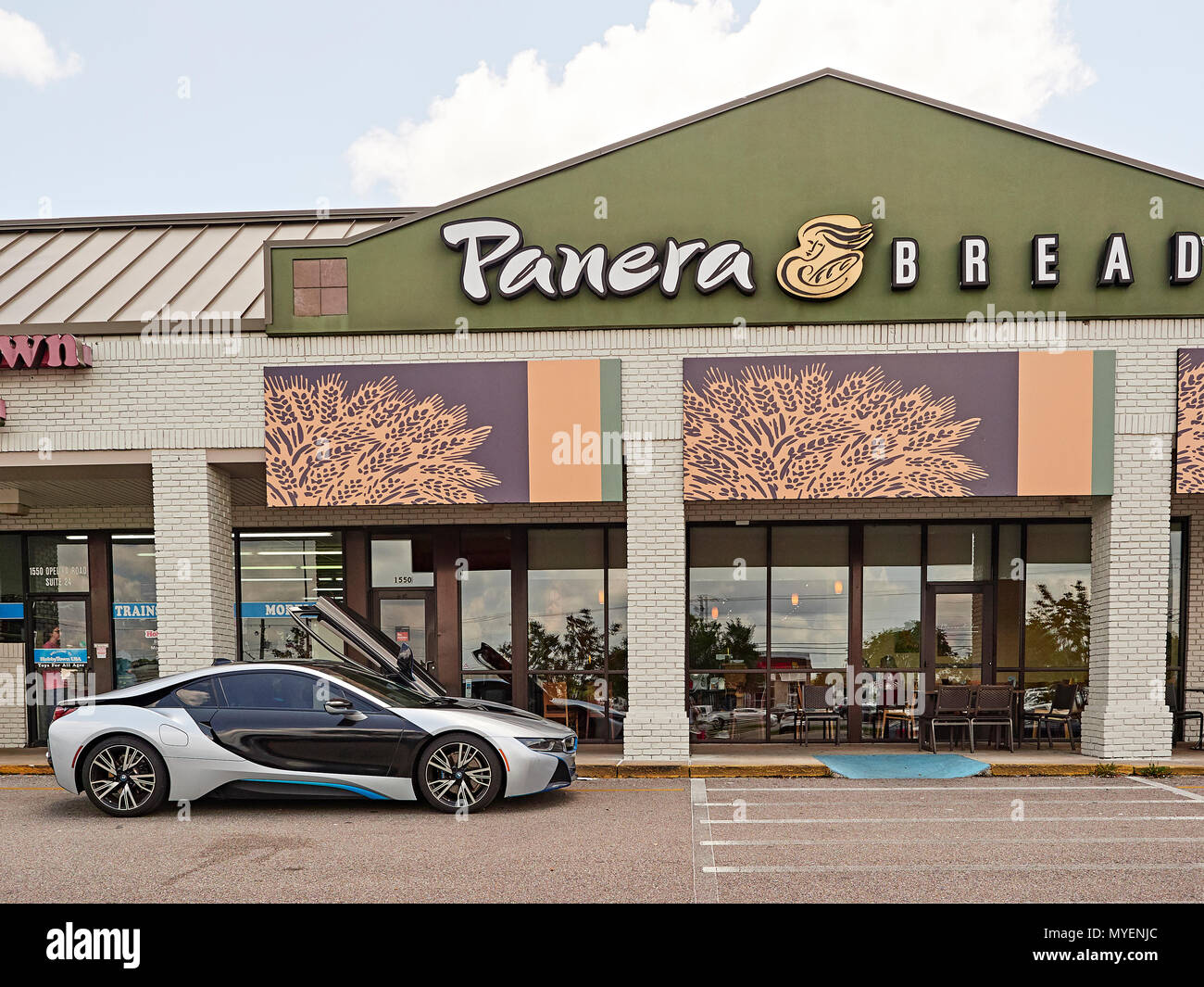 BMW i8 luxury electric hybrid plug-in super car parked in front of Panera Bread in Opelika Alabama, USA. Stock Photo