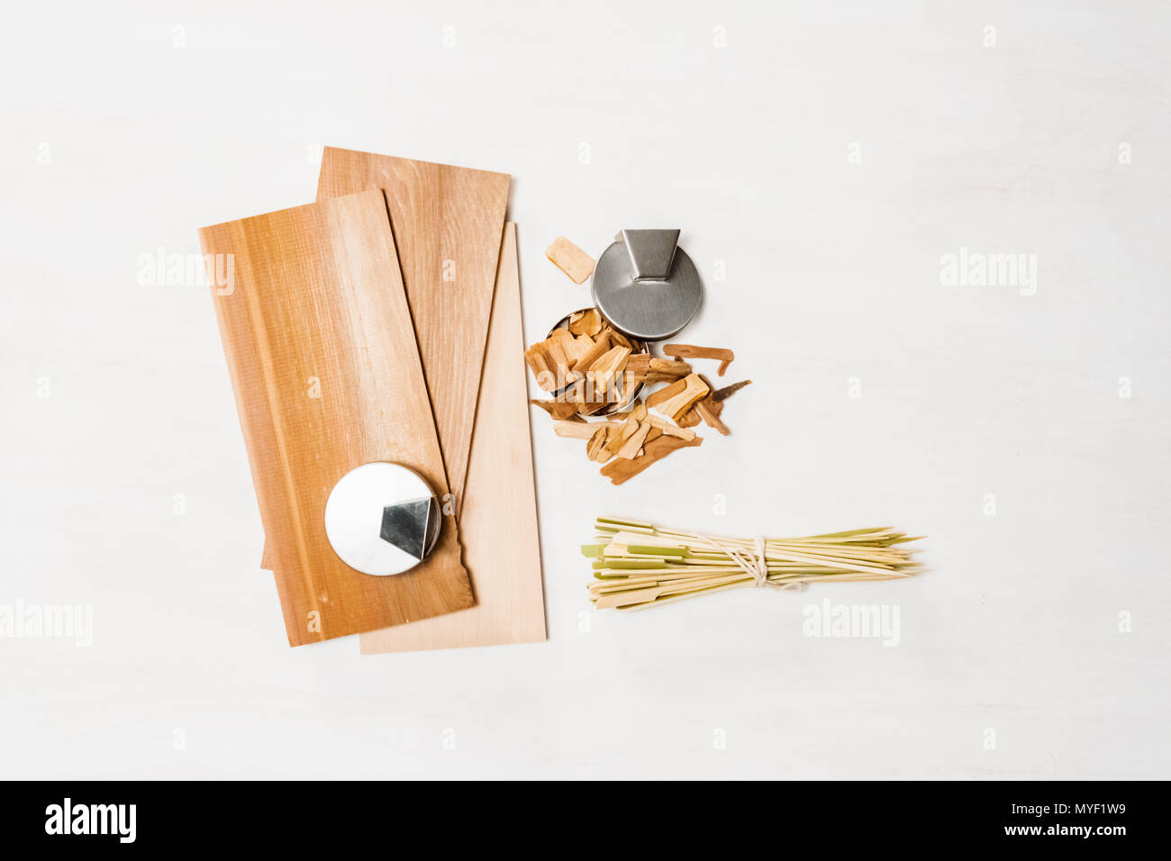 Hickory and cedar wood grilling planks and wood skewers Stock Photo