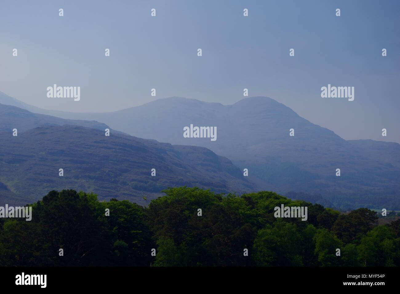 Torridon Mountains and Woodland of NW Scottish Highlands under Smoky Sky of a Wildfire. UK. - Stock Image