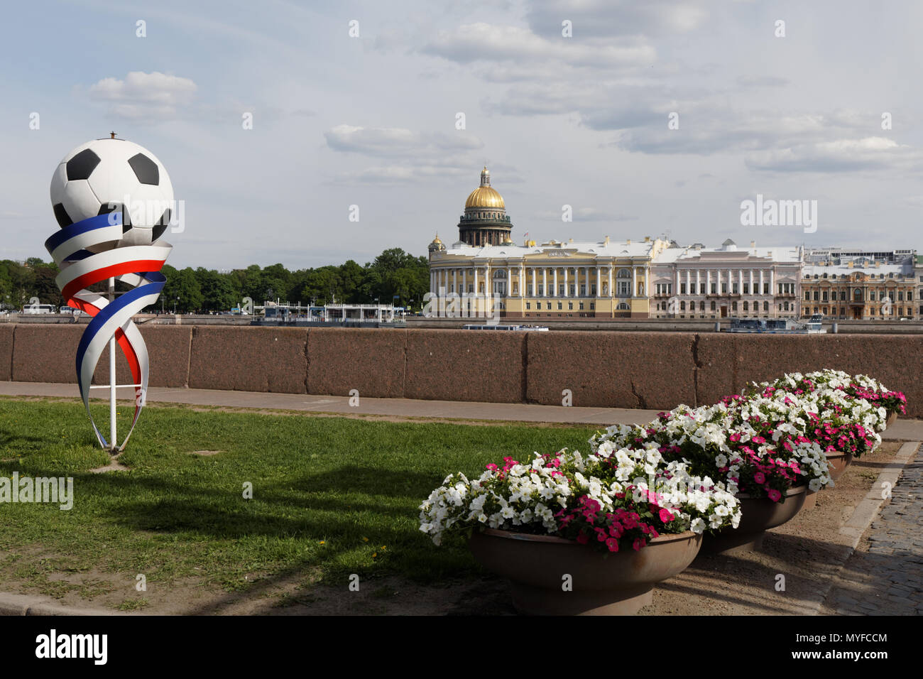Installation with a ball against Neva river and St. Isaac's cathedral. Saint Petersburg prepares to hosting FIFA World Cup 2018 - Stock Image