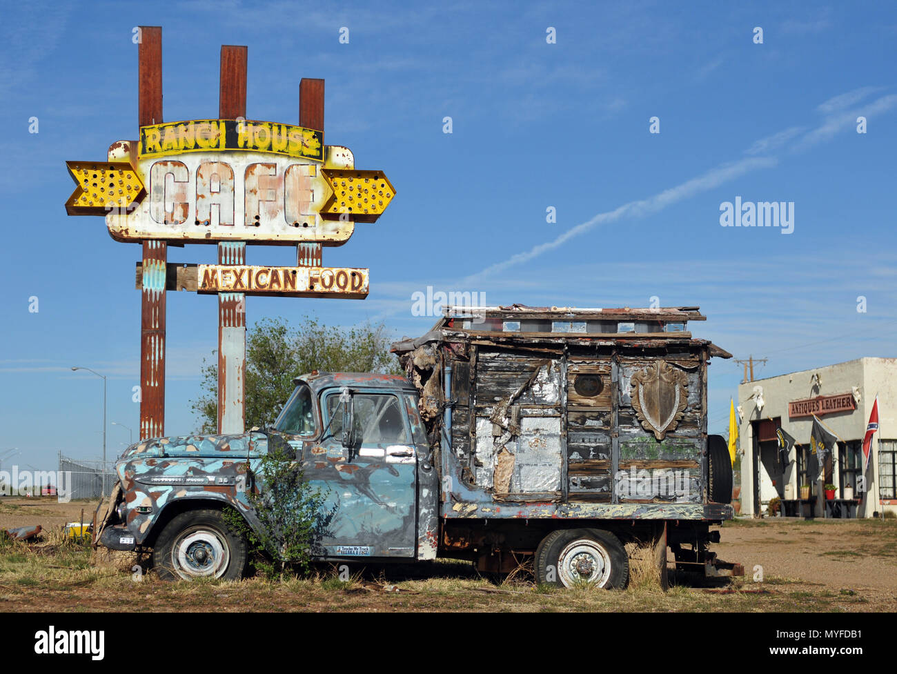 A dilapidated Chevrolet Apache truck sits in front of the rusting neon Ranch House Cafe sign in the Route 66 town of Tucumcari, New Mexico. - Stock Image