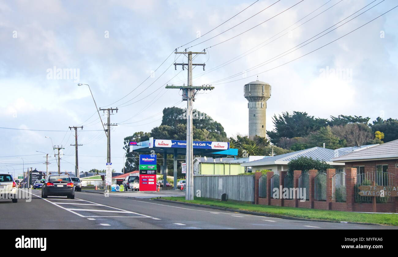 Traffic traveling on State Highway One passing through Foxton, New Zealand. - Stock Image