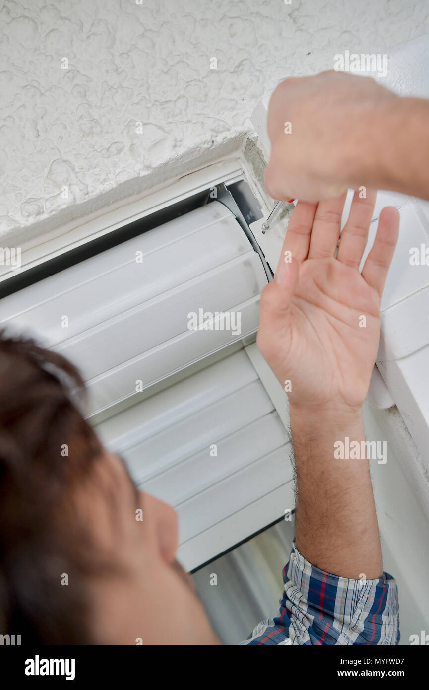 fixing the rolling blinds - Stock Image